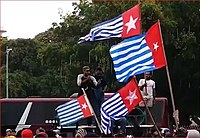 Papuan separatist rally with a flying of the banned Morning Star flag.