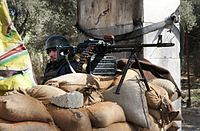 A Syrian Army soldier manning a checkpoint outside of Damascus shortly after the outbreak of the Syrian Civil War, 2012