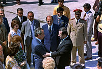 Hafez al-Assad greets Richard Nixon on his arrival at Damascus airport in 1974