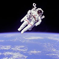 NASA astronaut Bruce McCandless II using a Manned Maneuvering Unit outside on shuttle mission STS-41-B in 1984.