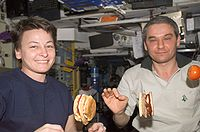 Astronauts making and eating hamburgers on board the ISS, August 2007