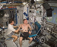 Gennady Padalka performing ultrasound on Michael Fincke during ISS Expedition 9.