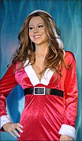 A Christmas-themed wax statue of Carey at Madame Tussauds San Francisco, reflecting Carey's status as a Christmas icon.