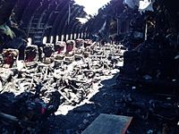 The charred middle cabin after the crash and fire