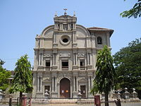 The facade of the Saviour of the World church under renovations. As with most of Goa, the church forms the center of the village.