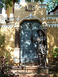 The gate outside Big foot museum with the statue of a guarding soldier.