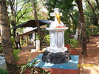 A typical roadside cross seen across Goa's villages and towns.