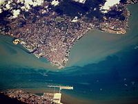 Aerial view of George Town. The city is physically separated from Butterworth (bottom) by the Penang Strait.