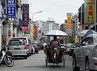 A trishaw, known locally as beca, on a street in George Town.