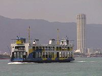 A Rapid Ferry crossing the Penang Strait towards George Town.