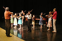 A Suzuki violin recital with students of varying ages