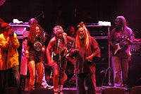 Funk places most of its emphasis on rhythm and groove, with entire songs based around a vamp on a single chord. Pictured are the influential funk musicians George Clinton and Parliament Funkadelic in 2006.