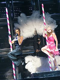 """Beckham and Bunton in Las Vegas, Nevada, on 11 December 2007, performing """"2 Become 1"""". Addressing the importance of contraception, Jennifer Keishin Armstrong in Billboard states it was among the songs where """"they embraced their sexuality""""."""