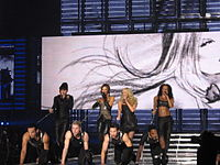 """The Spice Girls as a four-piece performing """"Holler"""" in Cologne, Germany at the Return of the Spice Girls tour"""