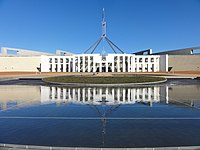 The federal bicameral Parliament of Australia, which contains a House of Representatives and a Senate