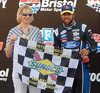 Wallace (right) with the Sunoco Rookie of the Race Award at Bristol Motor Speedway in 2015