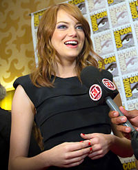 Stone at the 2011 San Diego Comic-Con International. Her hair, eyes, and husky voice have been described as her trademarks by the media.