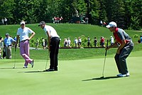 Geoff Ogilvy with Ian Poulter and Sergio García at the 2009 Telus World Skins Game in Lévis, Canada