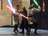 Qui-Gon Jinn and Obi-Wan Kenobi dueling Darth Maul. Lucas wanted the lightsaber battles to be fast and more intense, depicting the Jedi in their prime. This scene was highly praised by critics and audiences.