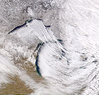 Cold northwesterly wind over the Great Lakes creating lake-effect snow. Lake-effect snow most frequently occurs in the snowbelt regions of the province.