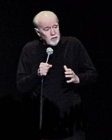 George Carlin performing his stand-up comedy routine in April 2008