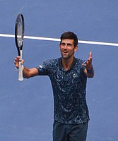 Djokovic celebrating at the 2018 US Open. His victory at the event tied him with Pete Sampras with 14 Grand Slam titles.
