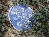 English Heritage blue plaque commemorating Sir Alfred Hitchcock at 153 Cromwell Road, London