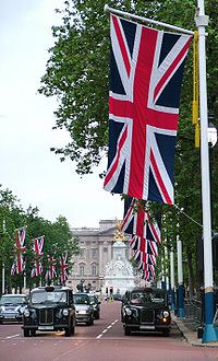 Union Flag being flown on The Mall, London looking towards Buckingham Palace