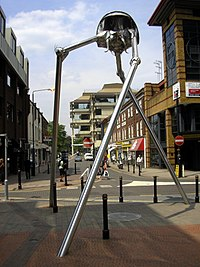 Statue of a tripod from The War of the Worlds in Woking, England, the hometown of author H. G. Wells. The book is a seminal depiction of a conflict between mankind and an extraterrestrial race.
