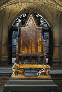 King Edward's Chair in Westminster Abbey. A 13th-century wooden throne on which the British monarch sits when he or she is crowned at the coronation, swearing to uphold the law and the church. The monarchy is apolitical and impartial, with a largely symbolic role as head of state.