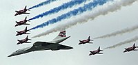 Concorde (and the Red Arrows with their trail of red, white and blue smoke) mark the Queen's Golden Jubilee. With its slender delta wings Concorde won the public vote for best British design.