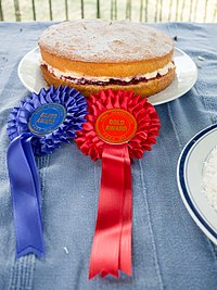 An award-winning Victoria sponge from an English village fête. Competitive baking is part of the traditional village fête, inspiring The Great British Bake Off television series.