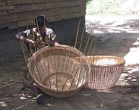 A woman weaves a basket near Lake Ossa, Littoral Region. Cameroonians practise such handicrafts throughout the country.