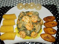 """Plantains and """"Bobolo"""" served with Ndolè (meat, and shrimp). Bobolo is made from cassava"""