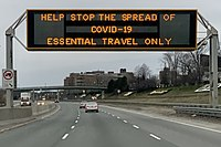 A highway sign in Toronto discouraging non-essential travel during the pandemic lockdown in March 2020