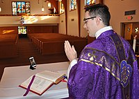 An American Catholic military chaplain prepares for a live-streamed Mass in an empty chapel at Offutt Air Force Base in March 2020.
