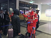 Civil Protection volunteers conduct health checks at the Guglielmo Marconi Airport in Bologna on 5February.