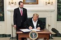 U.S. President Donald Trump signs the Coronavirus Preparedness and Response Supplemental Appropriations Act into law with Alex Azar on 6March 2020.
