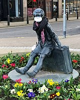 """The """"Wee Annie"""" statue in Gourock, Scotland, was given a face mask during the pandemic."""