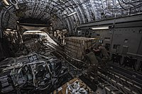U.S. Air Force personnel unload a C-17 aircraft carrying approximately 4000 lb of medical supplies in Niamey, Niger.