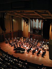Seattle Symphony Orchestra on stage in Benaroya Hall in Downtown Seattle. Benaroya has been the symphony's home since 1998.
