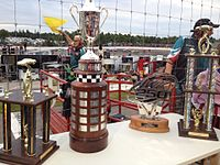 From left to right: IWK 250 3rd Place Trophy, John W. Chisholm Memorial Cup, IWK 250 Trophy Presented by Steve Lewis Auto Body, IWK 250 2nd Place Trophy