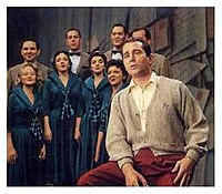 """Como and the Ray Charles Singers on the set of The Perry Como Show during """"Sing To Me, Mr, C."""" segment, c. 1950s. Como's """"sweater era""""."""