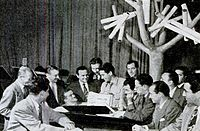 """Como meeting with songwriters' representatives in the """"Supper Club"""" studio. He met with the """"song pluggers"""" every Wednesday following the West Coast broadcast of Chesterfield Supper Club."""