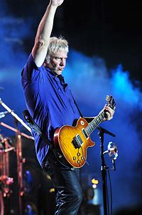 Lifeson playing his Gibson Les Paul in the 'Heritage Cherry Sunburst'. This guitar has been modified to incorporate a Floyd Rose tremolo.
