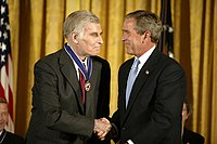 Heston is presented the Presidential Medal of Freedom by President George W. Bush in 2003