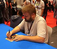 Co-creator Robert Kirkman signing a copy of the first issue at the 2011 New York Comic Con.