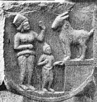 Woman with child and goat.