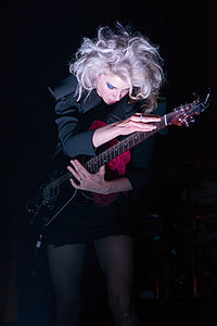 """St. Vincent performing in concert during her """"Digital Witness"""" tour in 2014"""