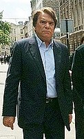 Bernard Tapie, a former French businessman who once owned Adidas but has since relinquished his control over the company due to debt